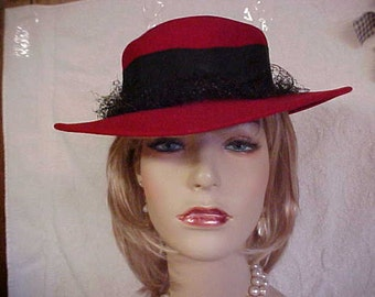 """Red wool fedora hat with wide black band  by designer """"Liz Claiborne"""" fits 22 inches"""