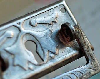 vintage  escutcheon... key hole plate...   Jan 54