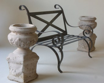 two mini cement urns and garden bench