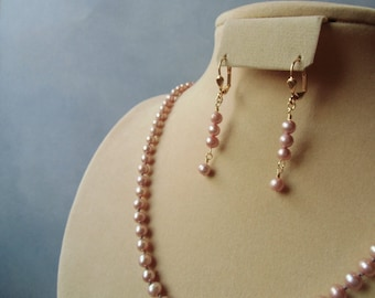 Dusty pink fresh water pearls, hand knotted, silk cord necklace and earrings set. Gold plated.