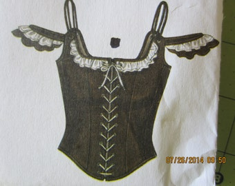 """black singles in concho Western show chaps in black smooth leather with suede side in, detailing at yoke & bottom, fringe, equitation back that works with single engraved silver concho & engraved silver buckle in front concho is engraved with a raised 5 flower pattern & rope edge approx 1 5/8"""" diameter, & front buckle has flowers & matching keeper & tip."""