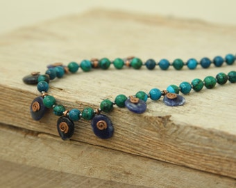 Chrysocolla with sodalite and handmade copper spirals elements.