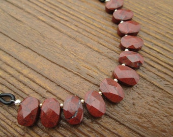 red jasper faceted ovals with sterling silver and black leather necklace
