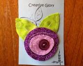 purple fabric flower clip