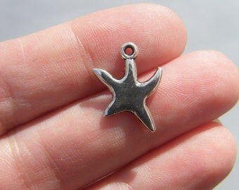 10 Starfish charms antique silver tone FF216