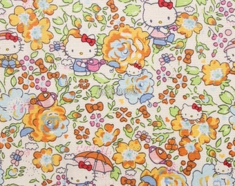 Liberty tana lawn - Felicite - Hello Kitty printed in Japan - Yellow blue mix