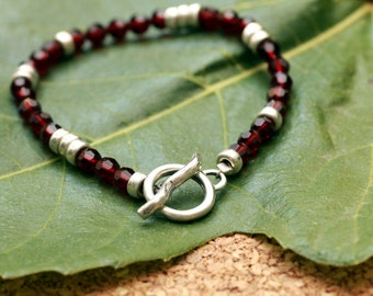 Simple and Classic:  Beaded Garnet Bracelet with Sterling Silver Roundels