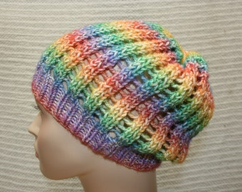 Handmade hand knitted pastel multi-colored slouch hat accented with metallic threads