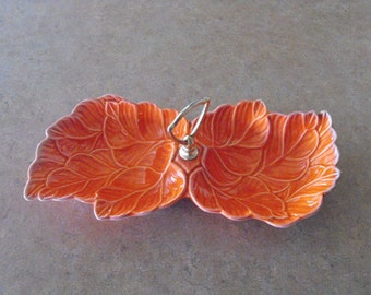 Vintage USA pottery orange relish dish
