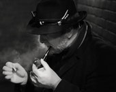 The smoking detective 8x8 vintage film noir, cinematic mood photograph