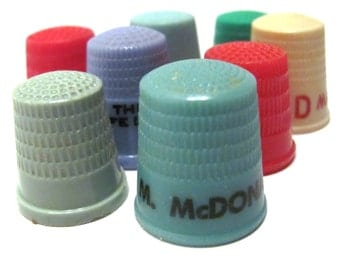Plastic thimble instant collection some with advertising