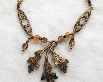 Triple leaf bronze woodland necklace