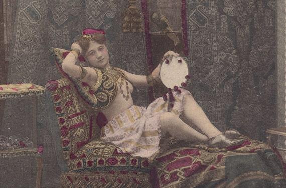 Risque Dancer, with Parrot, at Rest. Belle Epoque Image, circa 1900