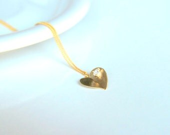 Gold plated heart charm pendant necklace with heart shaped zircon crystal on it, a perfect gift for her with minimalist style