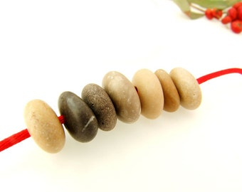 Center Drilled Beach Stones - Fat Donutish Stones- Beige and more Round Donut Pebbles- 7 psc