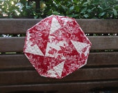 Red and white origami table topper