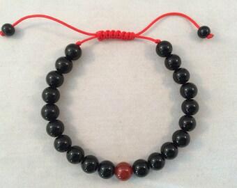 Black Onyx Wrist mala/ Bracelet for meditation with Carnelian Spacer