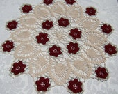 Elegant hand-crocheted rose and pineapple table top doily