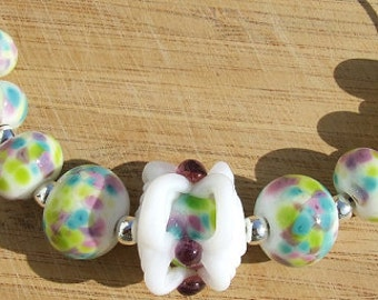 Caged - lampwork bead set
