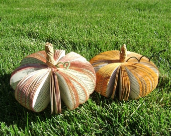 A mini book paper pumpkin for fall Thanksgiving decorations, wedding place card or table numbers centerpieces