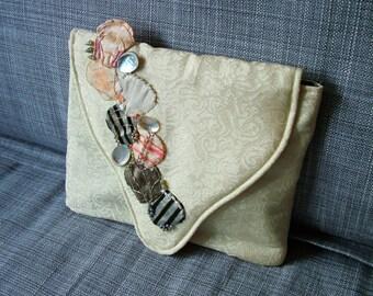 Handmade OOAK fabric clutch bag based on a shell design.