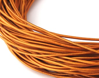 LRD0105065) 1 meter of 0.5mm Indian Sun Metallic Round Leather Cord