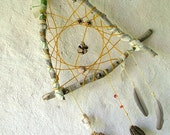 OOAK triangular eye catching dream catcher weaved in mustard yellow with seashells and many natural surprises