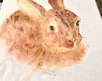 This rabbit is looking for a carrot. Hand painted  in soft browns would delight any kitchen.