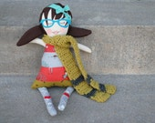 doll. nerdy bookworm with glasses. long scarf.  hello doll
