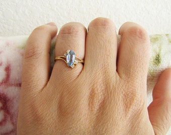Estate 14K Gold CZ Aquamarine Ring decorated with 4 small round clear cz (size 5)