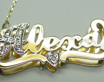 name  necklace ,  14k solid gold ,one diamond in a heart ,  .  solid gold  chain