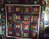 a nine patch log cabin quilt