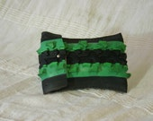 Bespoke green and black pouch made from a recycled bicycle tyre.