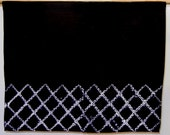 Black noren with traditional fence pattern in shibori (a traditional Japanese door hanging)