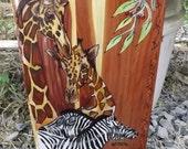 Giraffes and Zebras on Red Cedar