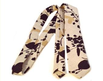 Skinny linen tie.  Beige linen necktie with black and gold floral design