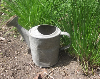 watering can. galvanized watering can, smaller size,