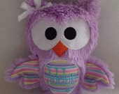 Fuzzy monogrammed  winged owl