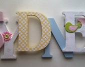 Wooden  letters for nursery in yellow,white,pink and blue