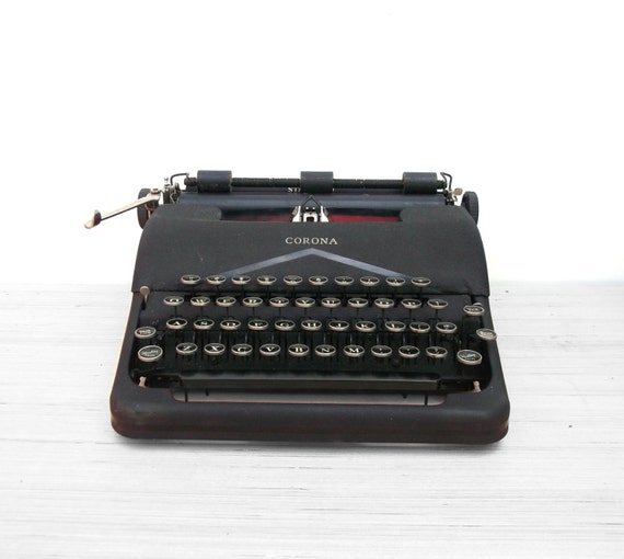old 1930s Coronoa typewriter with case
