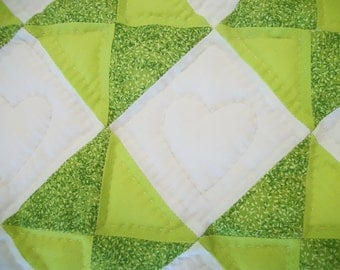 Green and white baby quilt, with hearts