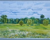 Braun Farm, Cloudy Day, original watercolor landscape painting, greens, blues, cloudy sky, trees, fields, farmscape
