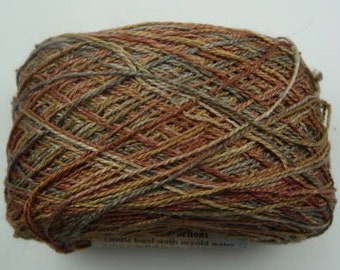 100% (color Taipan)Cultivated Silk yarn from Kaalund yarns of Australia.