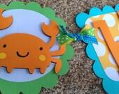 Boys whale, crab, Under the Sea Birthday banner in bright colors: orange aqua, yellow, green.  Beach theme banner