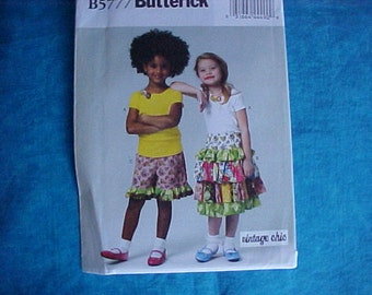 Butterick 5777 Size 2-3-4-5 Ruffle skirts shorts and top.