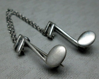silver music note double pin , it looks like sterling  maybe BEAU ?