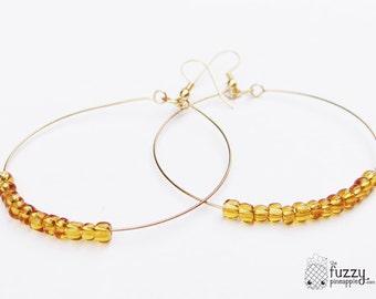 Simple Beaded Hoop Earrings in Amber by The Fuzzy Pineapple Jewelry