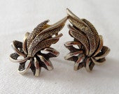 Earrings clip brassy pinwheel shapes with triple comet tails flames
