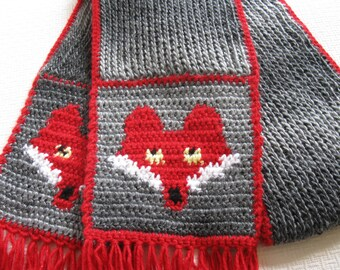 Knit fox scarf.  Knitted, shades of gray scarf with crochet red foxes
