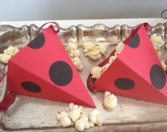 Paper party supplies lady bug cones, perfect for popcorn, treat holder to make your lady bug them complete.